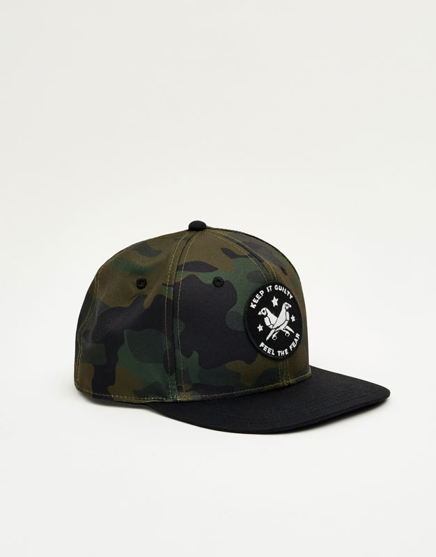 Camouflage cap with patch