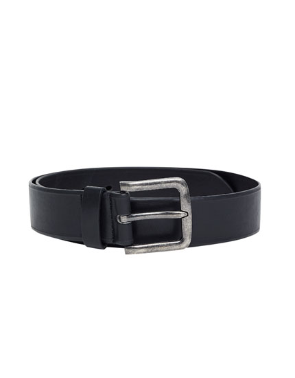 Belt with a metal buckle