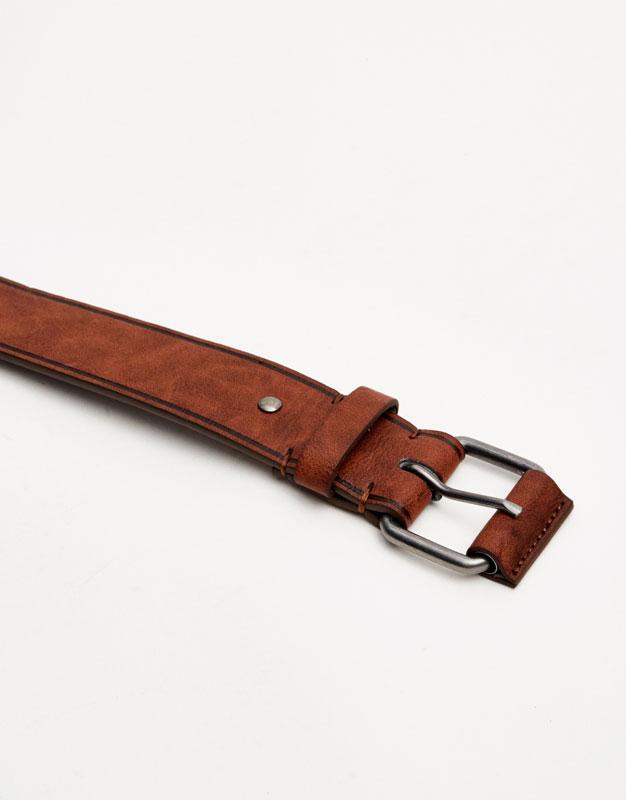 Brown belt with metal buckle