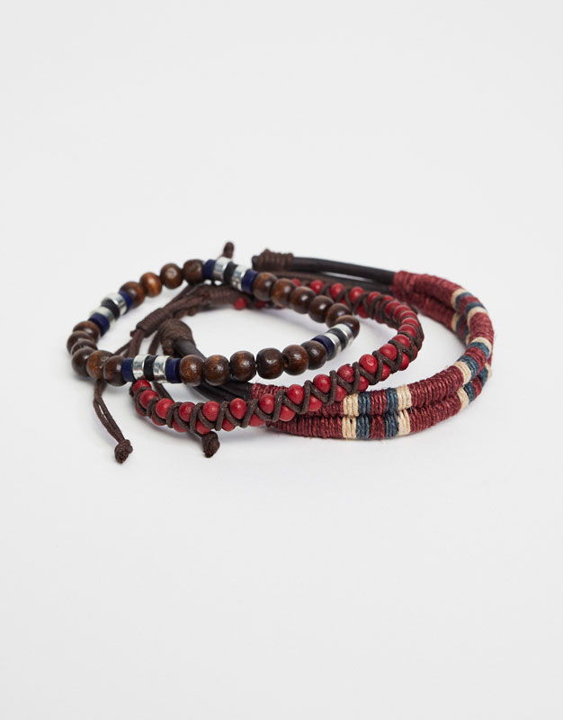 Red thread and beaded bracelets