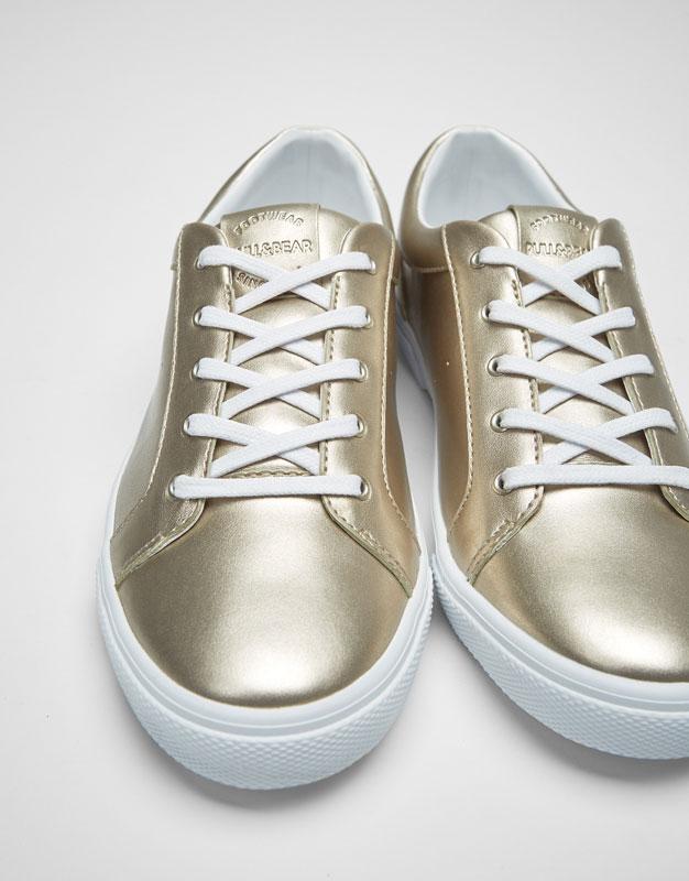 Basic golden metallic plimsolls