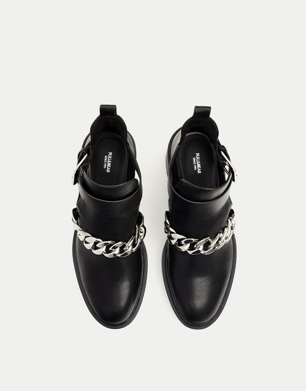 Cut-out ankle boots with chain detail