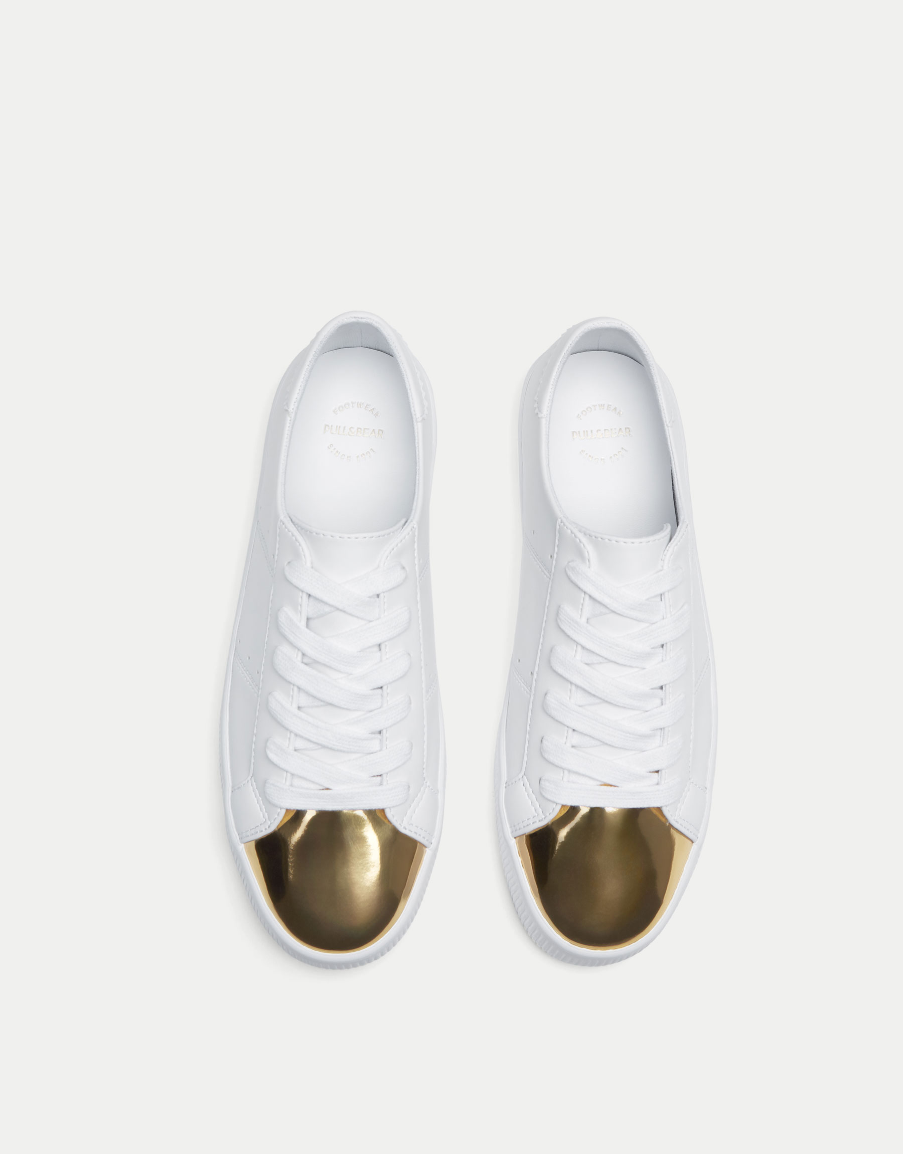 Sneakers with gold toe cap