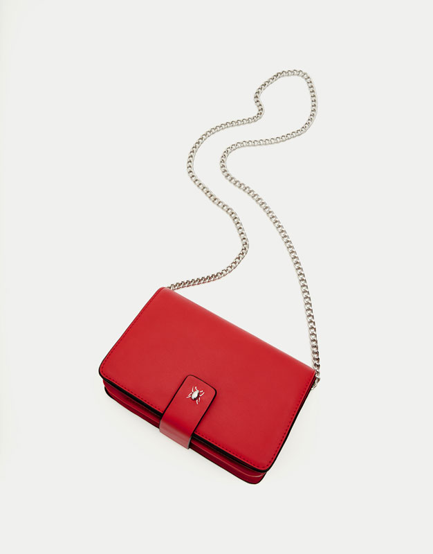 Red crossbody bag with fastener detail
