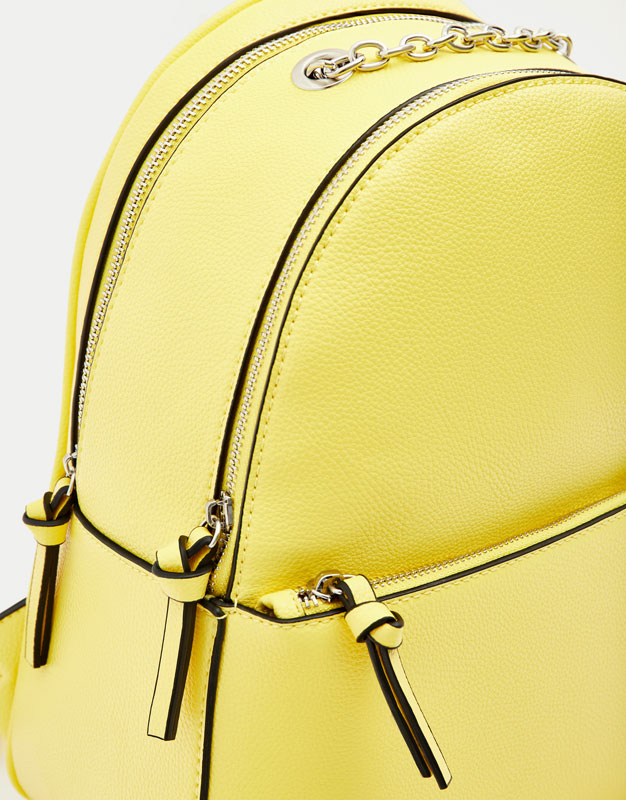 Yellow backpack with chain detail