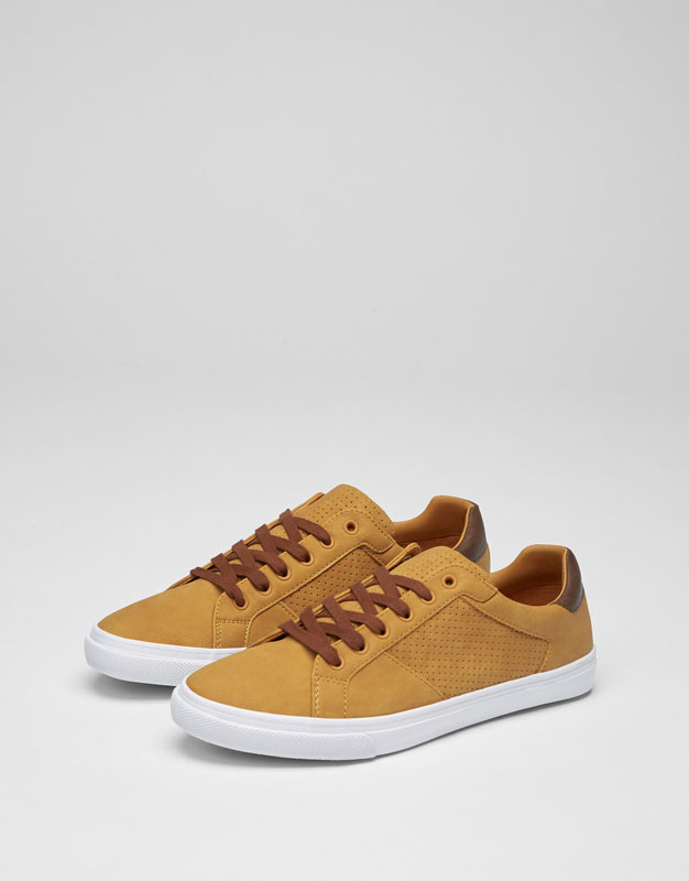 Brogued plimsolls with leather heel