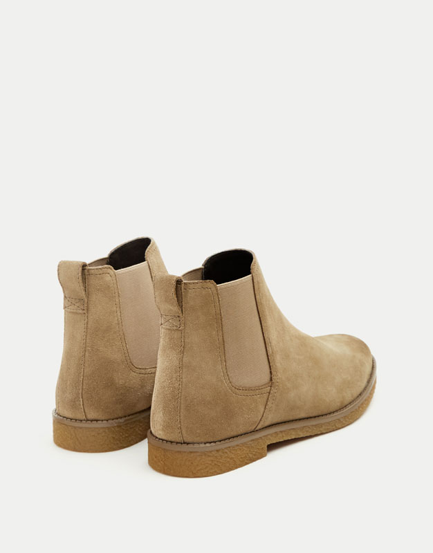Sand-coloured elastic split suede boots