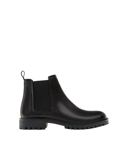 Black elastic leather boots
