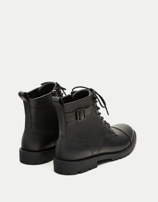 Toe cap boots with buckles