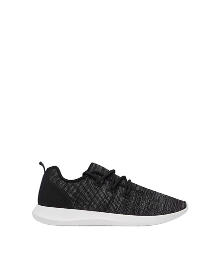 Black asymmetric sneakers