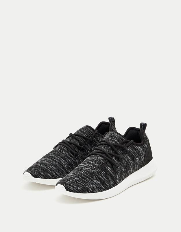 Black asymmetric sneakers