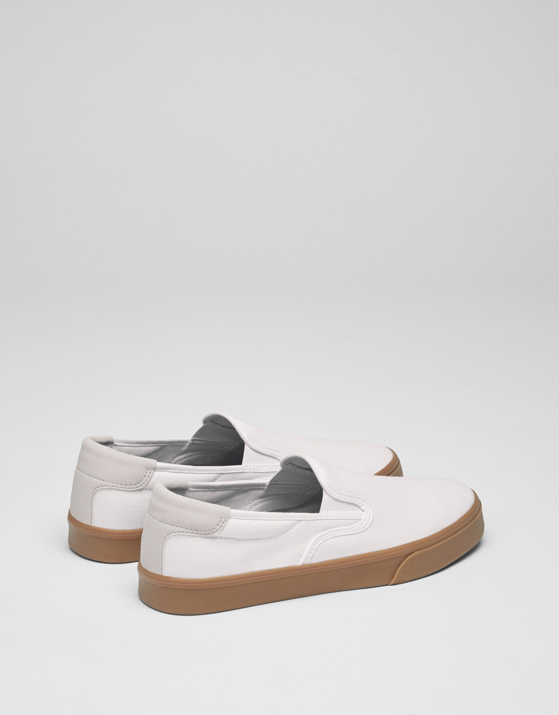 White sneakers with a caramel sole.