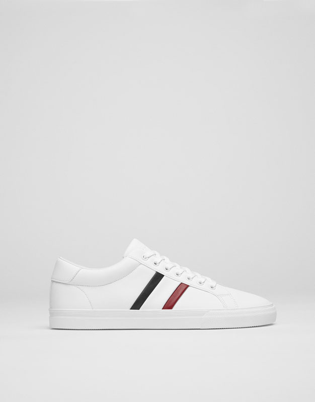 White sneakers with side stripes