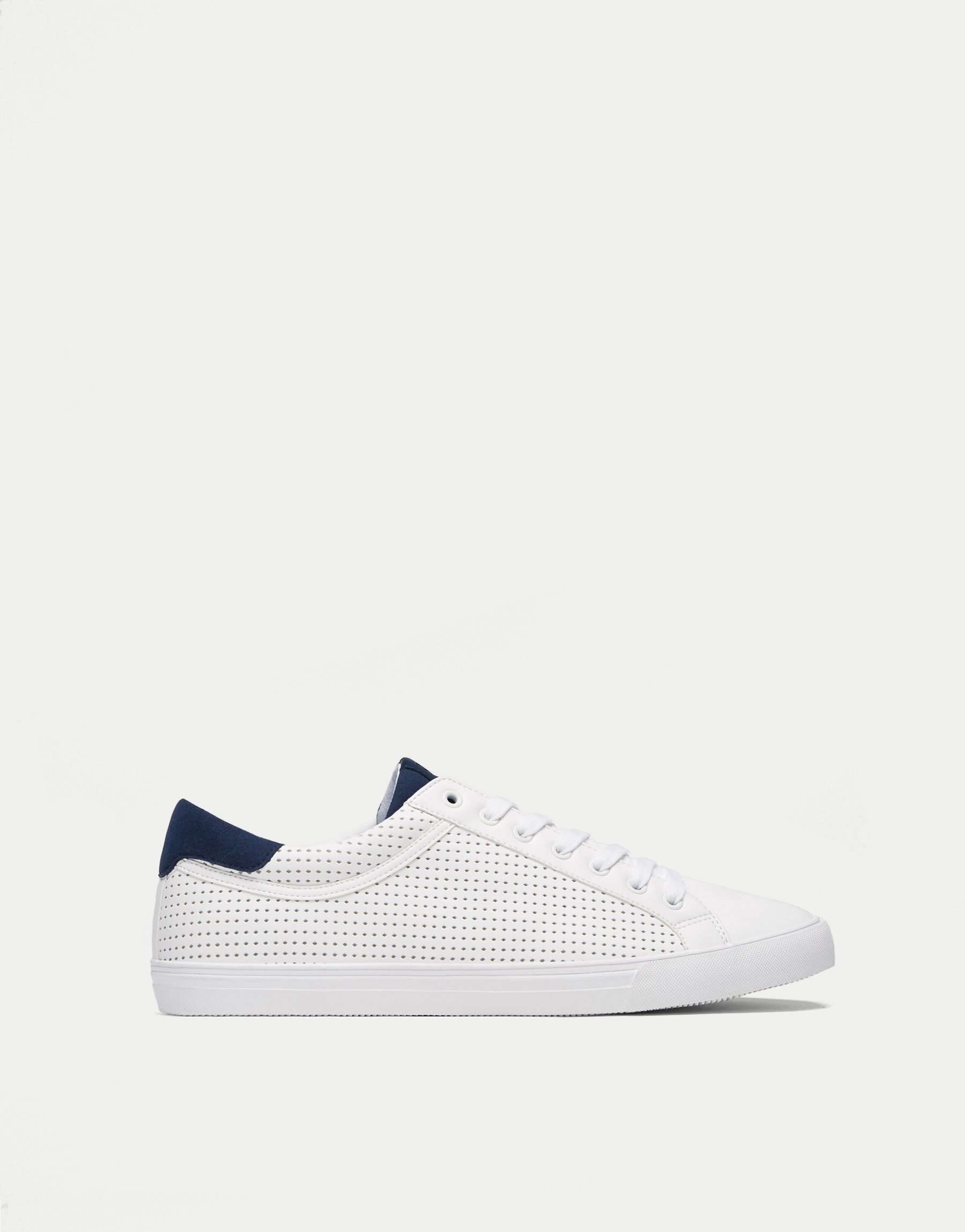 Die-cut plimsolls with blue trim
