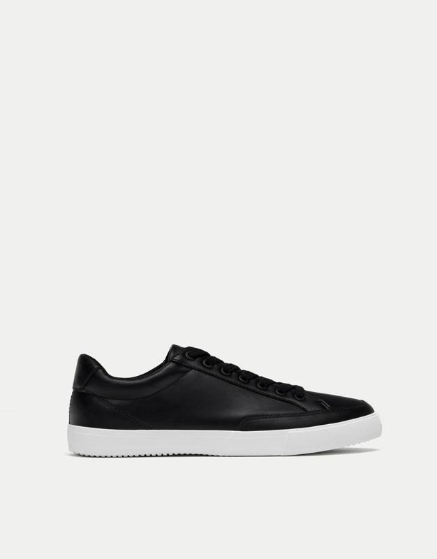 Black embossed sneakers