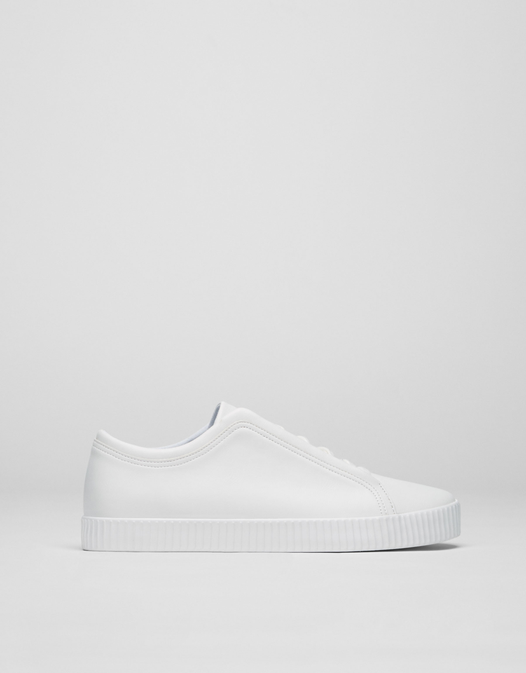 White plimsolls with concealed laces