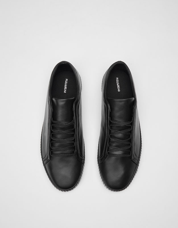 Black plimsolls with concealed laces