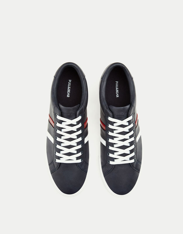 Blue sneakers with side stripes