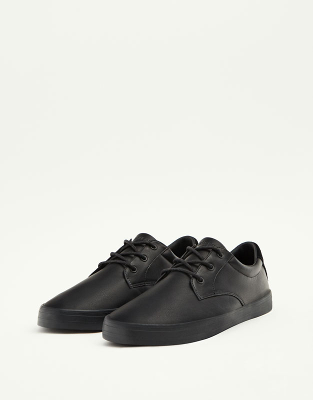 Black coated sneakers