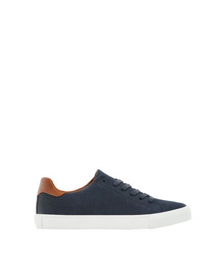 Blue, die-cut plimsolls with heel detail