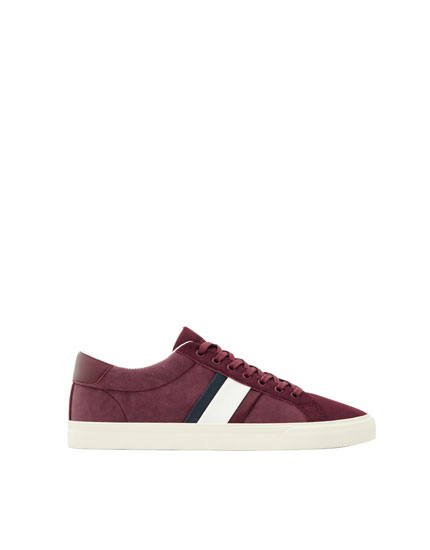 Striped maroon sneakers