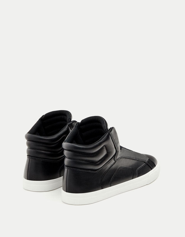 Black quilted high-top sneakers