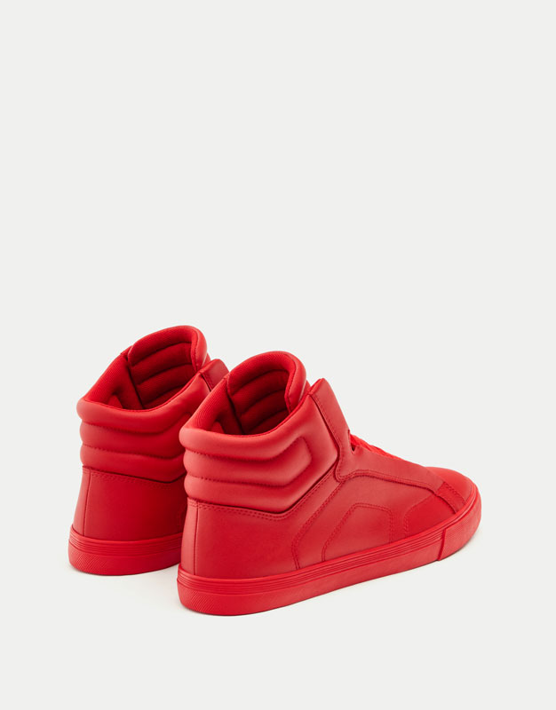 Red quilted high-top sneakers