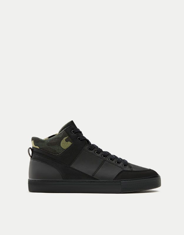 Black high top sneakers with camouflage detail
