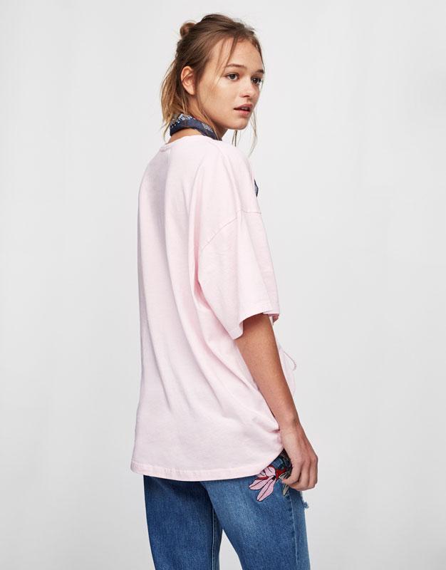 Camiseta oversized texto corsario cintura