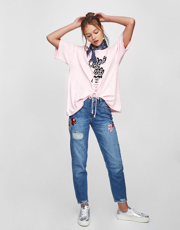 Oversized slogan T-shirt with lace-up waist