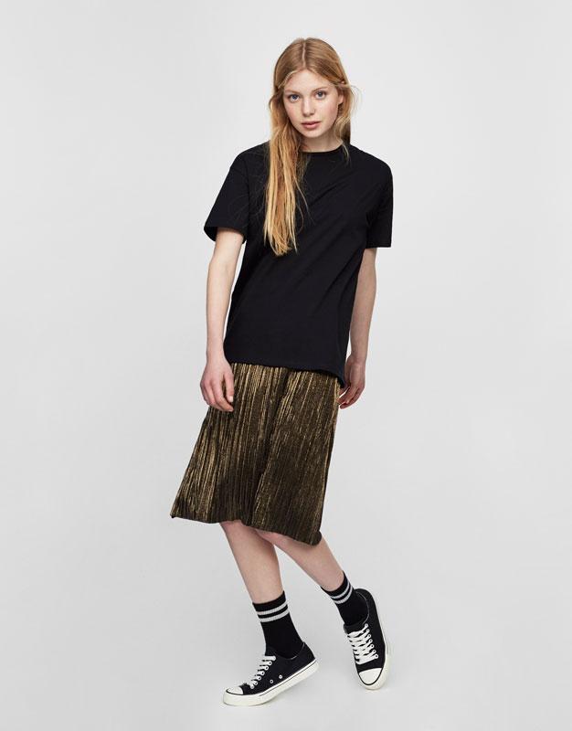 Dress with shiny skirt