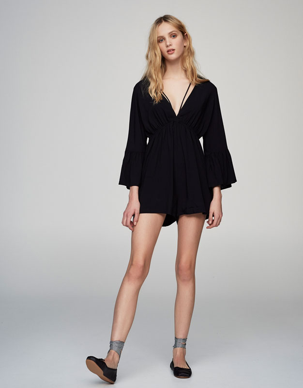 Jumpsuit with a strappy neckline and belled sleeves