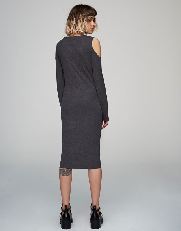 Elastic dress with cut out shoulders