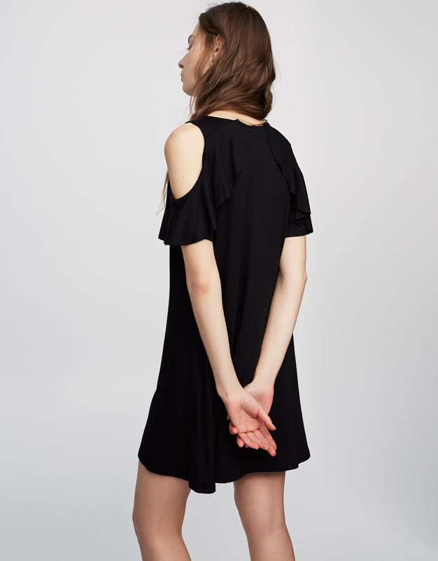 Dress with cut out and frilled shoulders