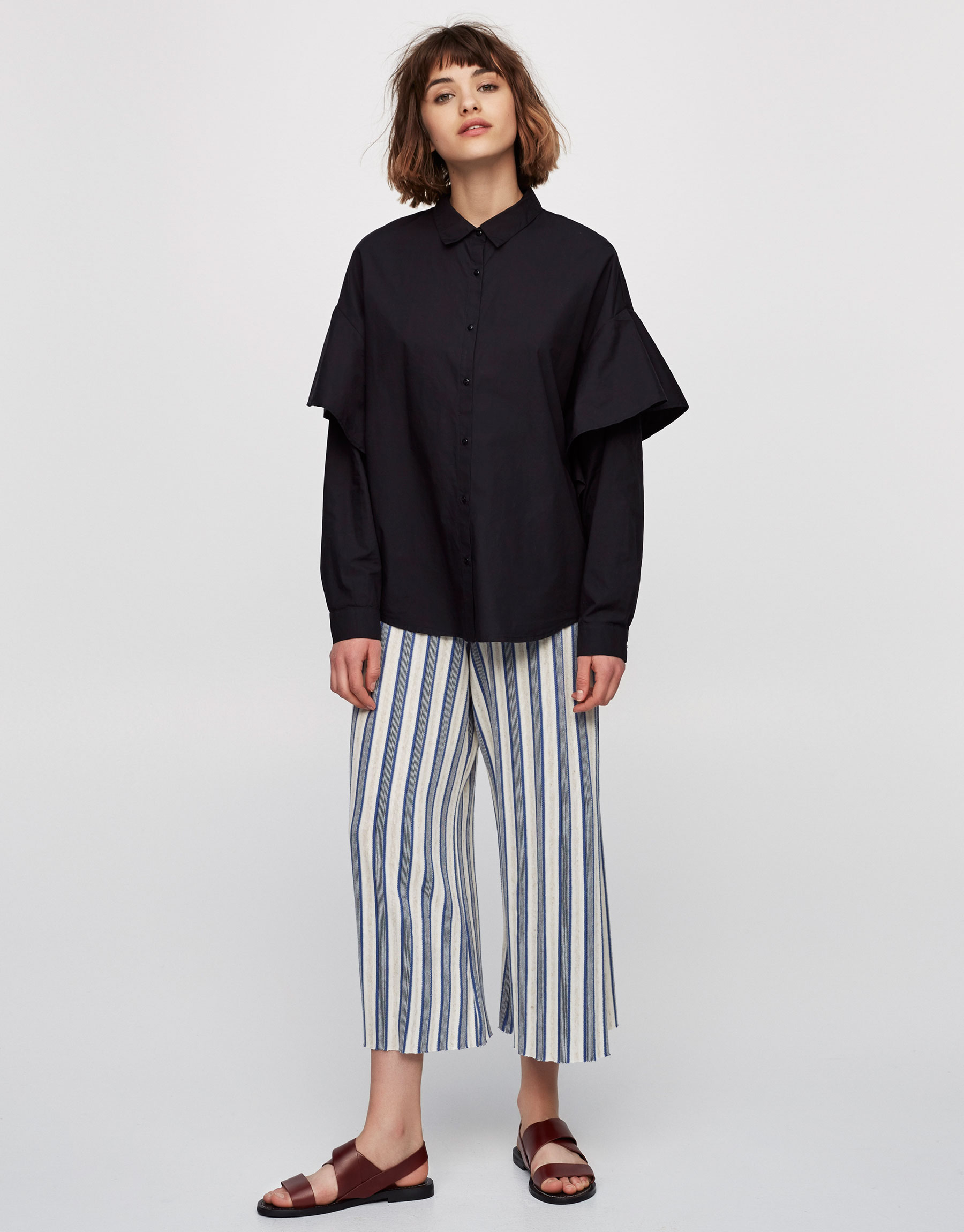 Oversized shirt with ruffled trims on the sleeves