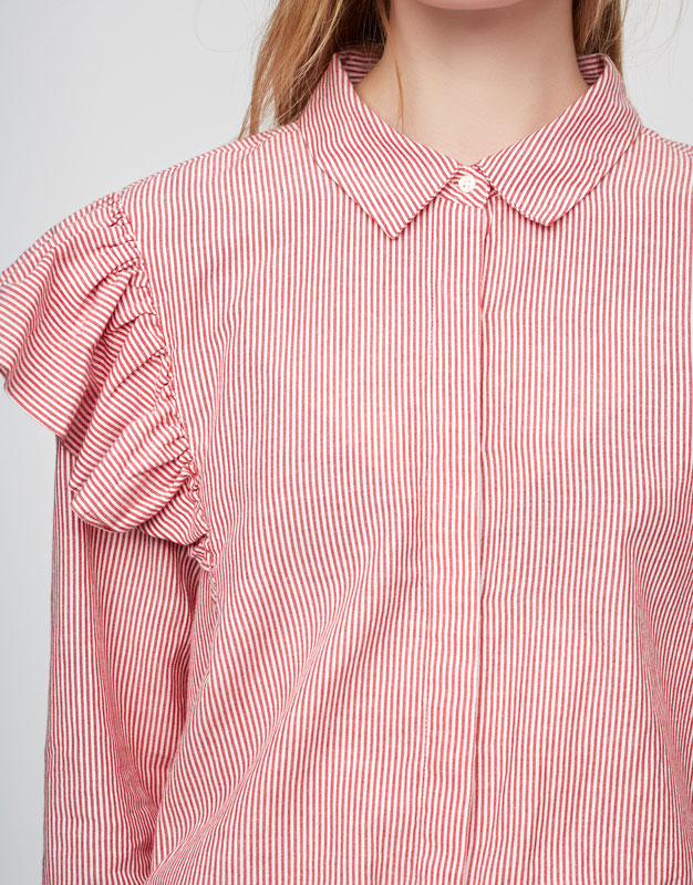 Striped shirt with frilled sleeves