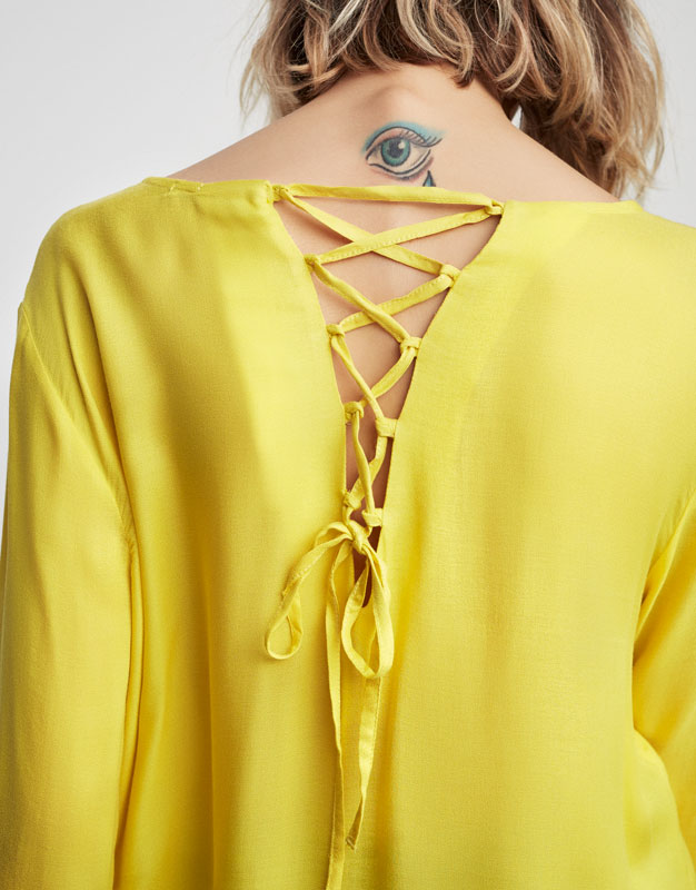 Top with corset back detail
