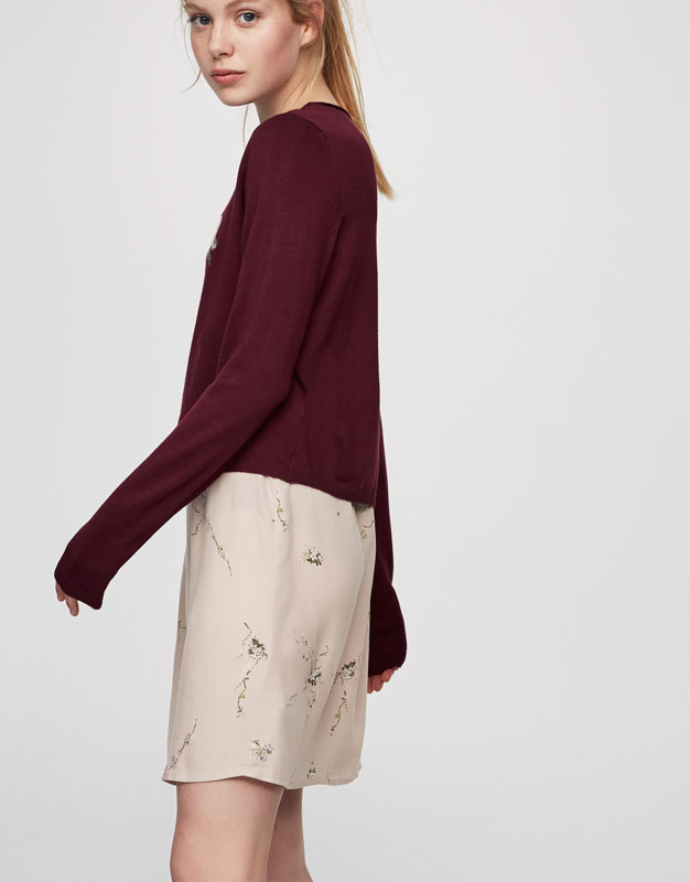 Sweater with rose patch