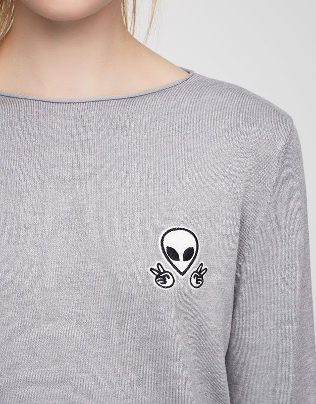 Sweater with alien patch