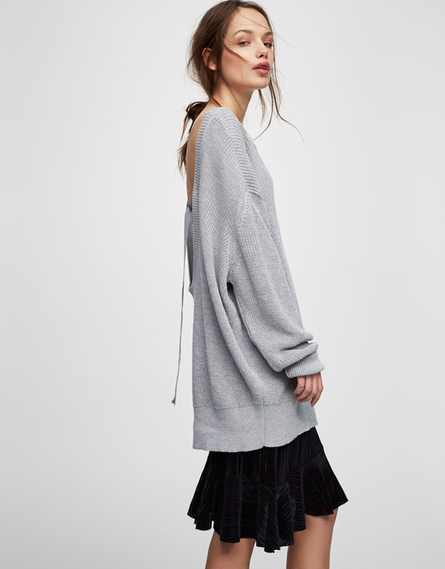 Oversized sweater with low cut back
