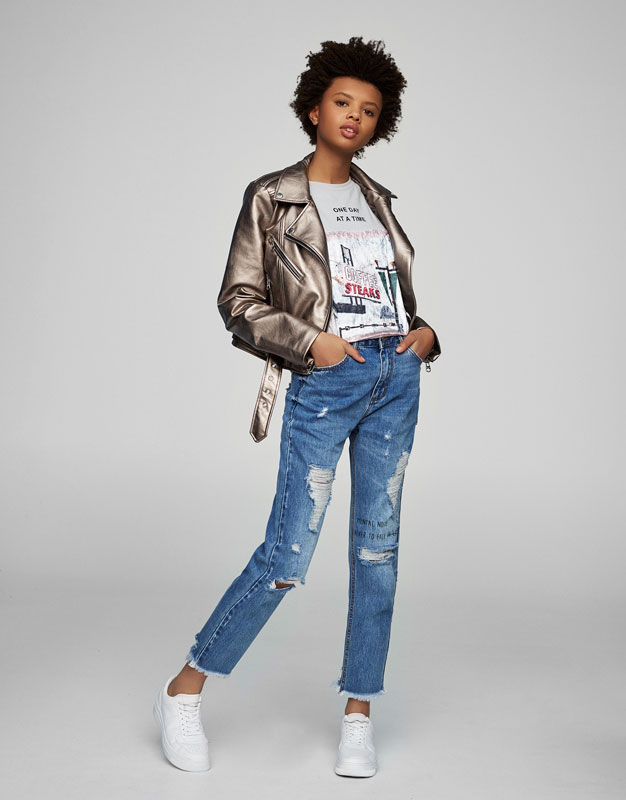Mom fit jeans with rips and text