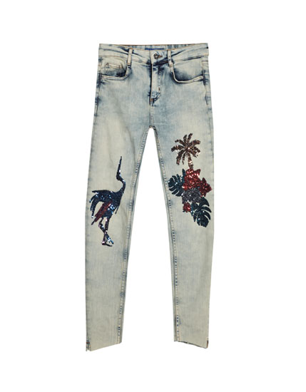 Sequinned print jeans