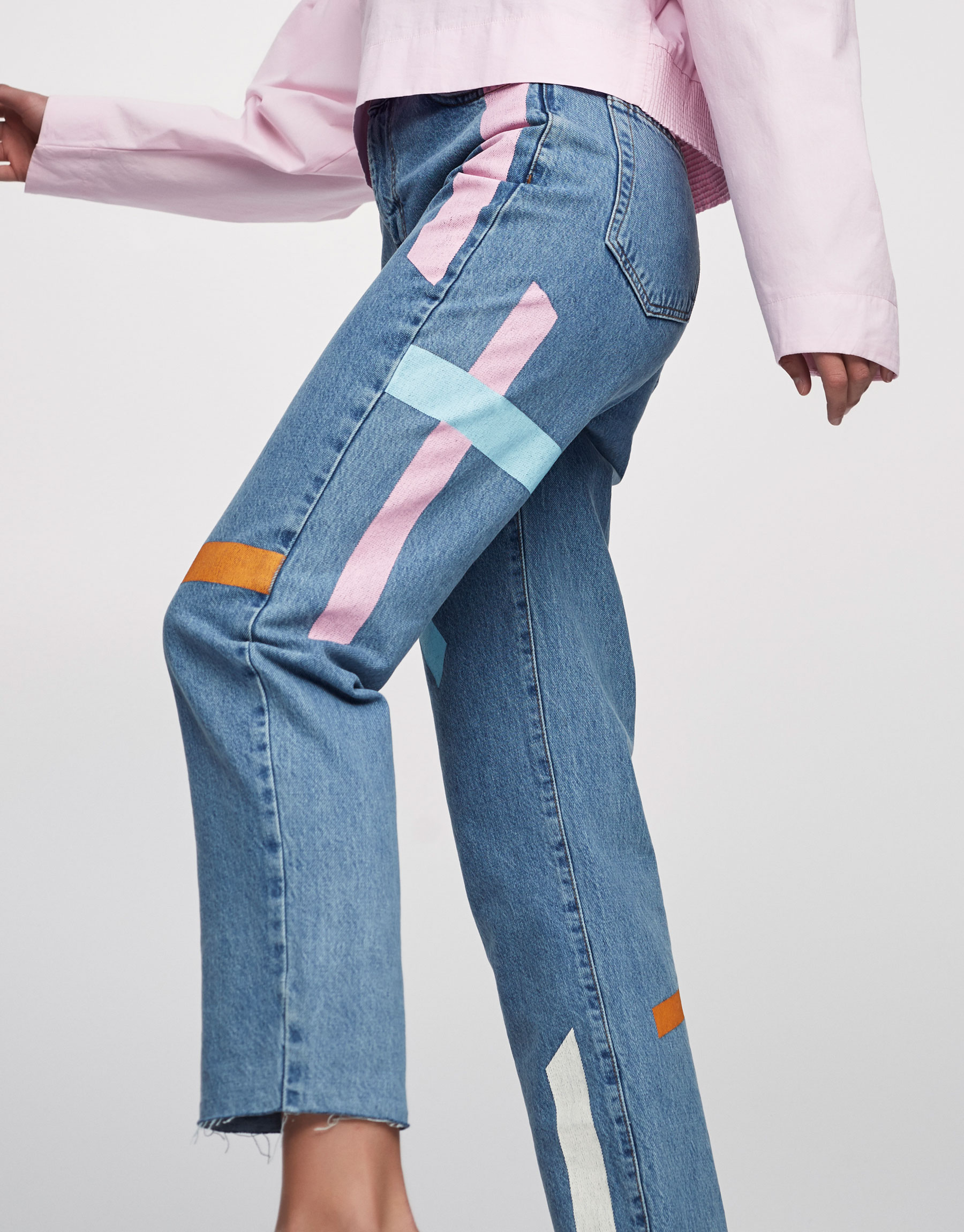 Mom fit jeans with colourful stripes