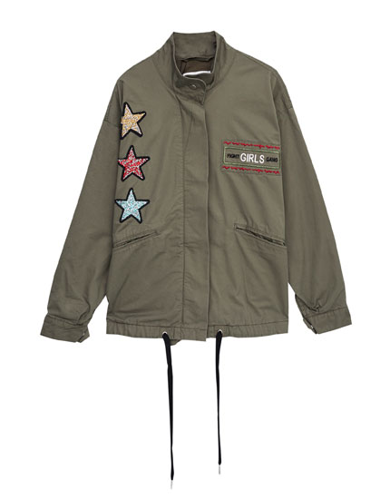 Oversized jacket with stars and eyelets