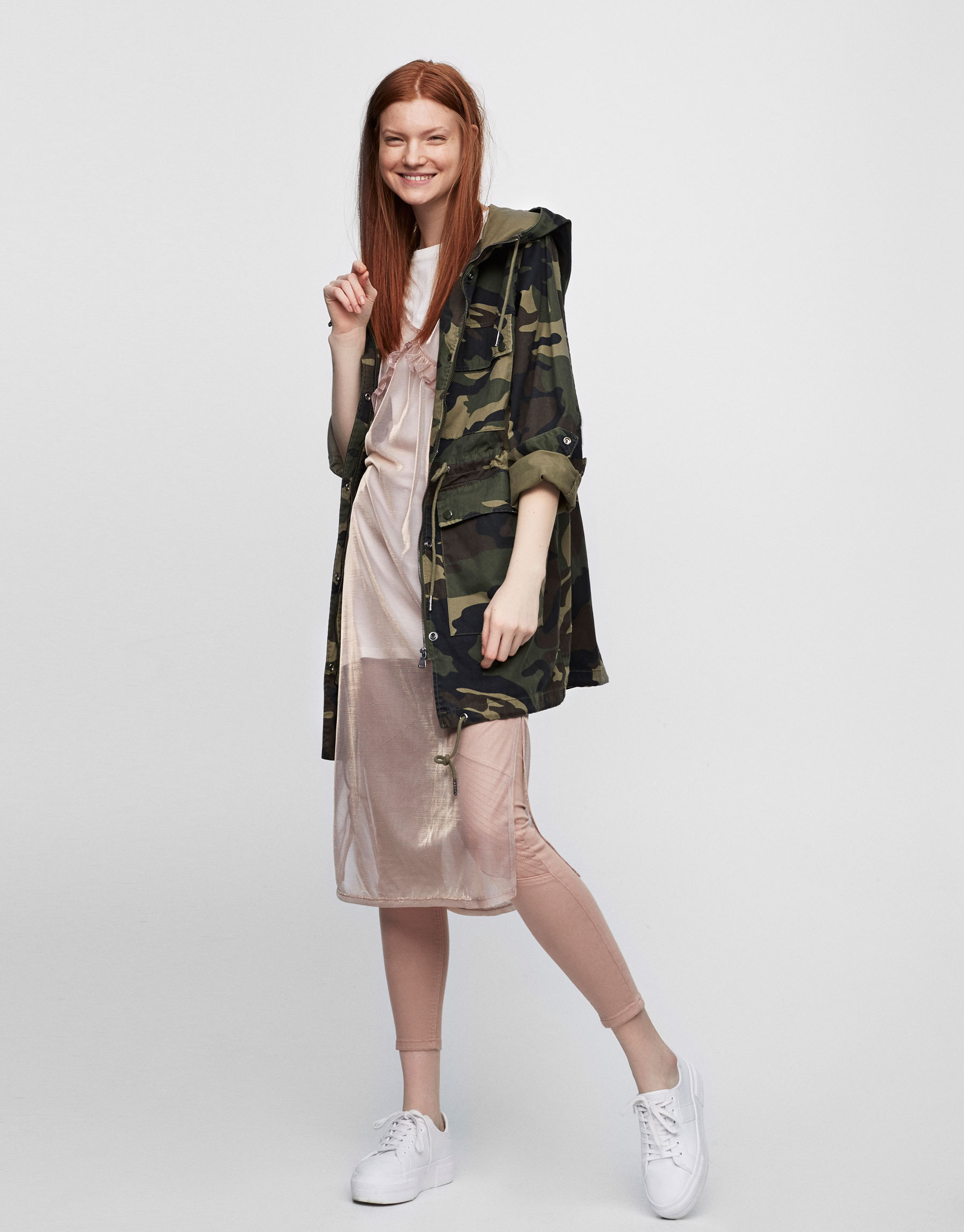 Camouflage parka with patches
