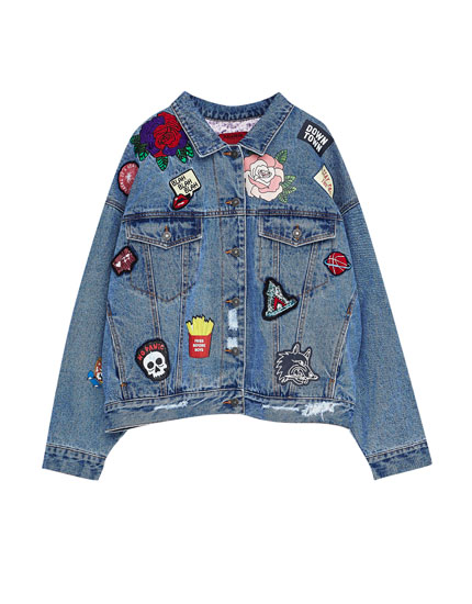 Oversized denim jacket with multiple patches