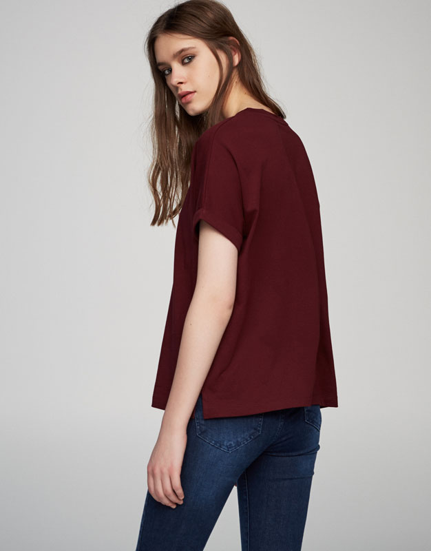 T-shirt with text on the sleeves