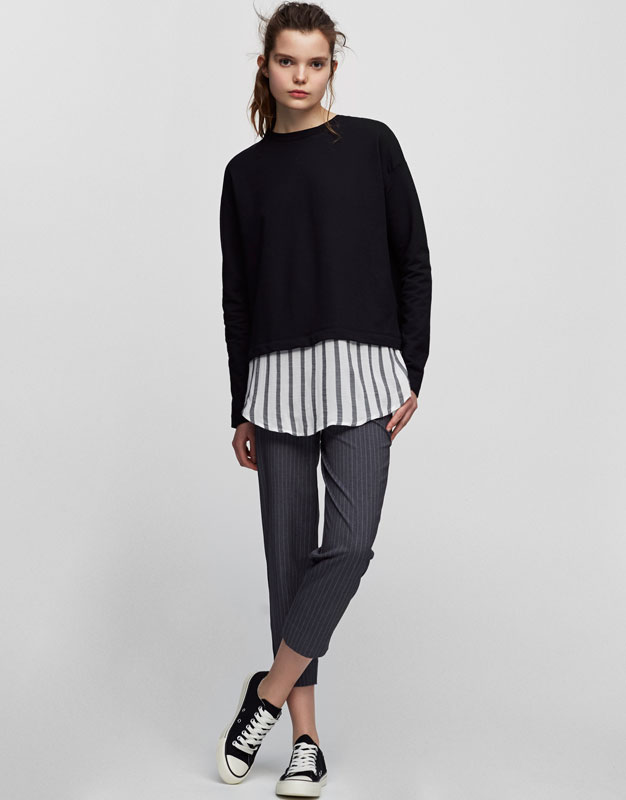 Sweatshirt with flowing shirt hem
