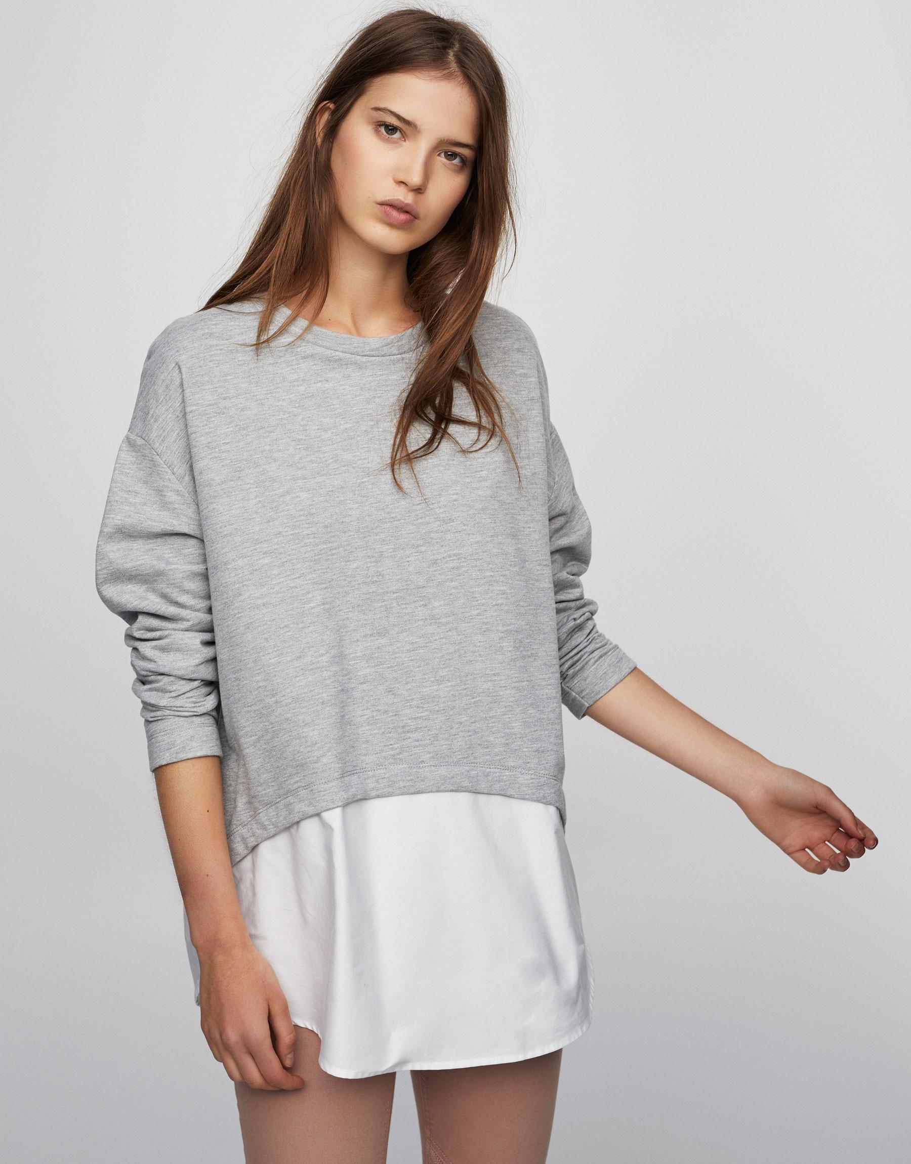 Sweatshirt mit Hemdeinsatz am Saum