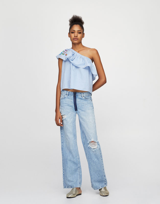 Ripped relaxed fit jeans with a zip detail